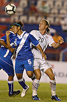 Action photo of Landy Barrios (L) of Guatemala and Abby Wambach of USA (R), at the 2010 CONCACAF Women's World Cup Qualifying tournament held at Estadio Quintana Roo in Cancun, Mexico.
