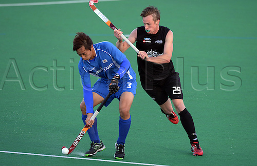 18.05.2013. Auckland, New Zealand.  Korea's Dae Yeol Lee and NZ's Hugo Inglis during the 3rd Hockey test match. New Zealand Men's Blacks Sticks v Korea. Saturday 18 May 2013. Pukekohe, Auckland.