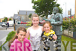 Zoe O'Gorman, Alison Enright and Lucy Shine pictured with a Statue of Bryan MacMahon in the Square, Listowel on Tuesday.