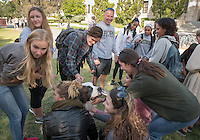 Football coach Doug Semones walks his dogs on campus and talks with students, Dec. 3, 2015.<br />