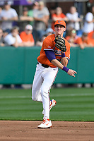 Shortstop Logan Davidson (8) of the Clemson Tigers throws out a runner in a game against the William and Mary Tribe on February 16, 2018, at Doug Kingsmore Stadium in Clemson, South Carolina. Clemson won, 5-4 in 10 innings. (Tom Priddy/Four Seam Images)