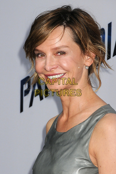Calista Flockhart<br /> &quot;Paranoia&quot; Los Angeles Premiere held at the Directors Guild of America, West Hollywood, California, USA, 8th August 2013.<br /> portrait headshot leather  silver grey gray sleeveless smiling <br /> CAP/ADM/BP<br /> &copy;Byron Purvis/AdMedia/Capital Pictures