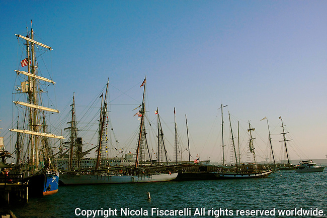 Tall ships are docked in the San Diego Harbor,California.