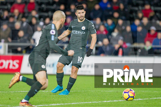 Sergio Aguero of Manchester City passes into the penalty area for David Silva during the EPL - Premier League match between Swansea City and Manchester City at the Liberty Stadium, Swansea, Wales on 13 December 2017. Photo by Mark  Hawkins / PRiME Media Images.