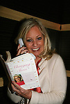 Tina Sloan shows off her new book Changing Shoes - Actors and fans have fun - Day 3 - August 2, 2010 - So Long Springfield at Sea - Carnival's Glory (Photos by Sue Coflin/Max Photos)