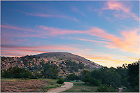 This photo from Enchanted Rock in the Texas Hill Country was taken about 15 minutes before sunrise on a very peaceful September morning. I did not expect the clouds to light up the way they did, but for a brief moment, sunlight and pastel colors really put on a show. As you can see, this is the trail to the top of the granite outcrop just 16 miles from Fredericksburg. It makes for a great trip on a not-so-hot day!