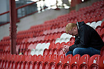 Brentford 0 Doncaster Rovers 1, 27/04/2013. Griffin Park, League One. Griffin Park hosts a showdown between two clubs aiming for automatic promotion from League One. A dejected Brentford supporter after the game. Photo by Simon Gill.
