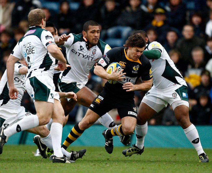 Photo: Richard Lane/Richard Lane Photography.London Wasps v London Irish. Aviva Premiership. 21/11/2010. Wasps' Ben Jacobs powers through the Irish defence.