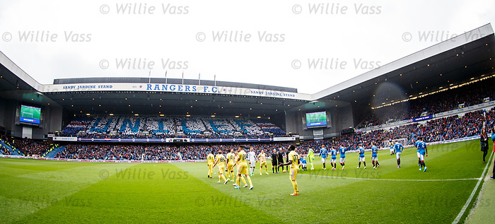 Rangers and Hearts walk out to a UNICEF display in the stands at Ibrox