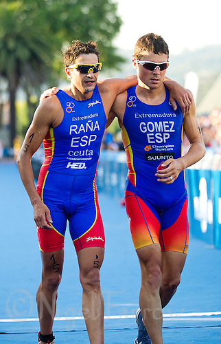 25 JUN 2011 - PONTEVEDRA, ESP - Javier Gomez (ESP) (right)  leaves the finish line with Ivan Rana (ESP) at the Elite Men's European Triathlon Championships in Pontevedra, Spain .(PHOTO (C) NIGEL FARROW)