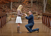 STAFF PHOTO BEN GOFF  @NWABenGoff -- 12/27/14 Jeremy Gunter proposes to his girlfriend Amanda Kirk, both of Sarasota, Fla., on the trails at Crystal Bridges Museum of American Art in Bentonville on Saturday Dec. 27, 2014. Gunter recruited family and friends to help arrange the surprise while the couple was in town for the holidays.