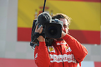 FERRARI SPANISH DRIVER FERNANDO ALONSO PLAYING WITH FOM TV CAMERA ON PODIUM AFTER FINISHING THIRD .Monza 9/9/2012 .Formula 1.Foto Insidefoto / Bernard Asset / Panoramic .Italy Only