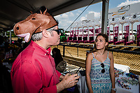 BALTIMORE, MD - MAY 19: A man in a Horse hat talks with a lady on Black-Eyed Susan Day at Pimlico Race Course on May 19, 2017 in Baltimore, Maryland.(Photo by Douglas DeFelice/Eclipse Sportswire/Getty Images)