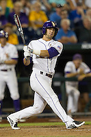 LSU Tiger pinch hitter Tyler Moore (2) follows through on his swing during Game 4 of the 2013 Men's College World Series against the UCLA Bruins on June 16, 2013 at TD Ameritrade Park in Omaha, Nebraska. UCLA defeated LSU 2-1. (Andrew Woolley/Four Seam Images)