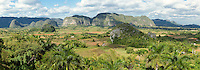 Cuba, Pinar del Rio Region, Valle de Viñales (Vinales) Area.  Limestone Mogotes Provide a Backdrop to Fields of Tobacco and Corn.