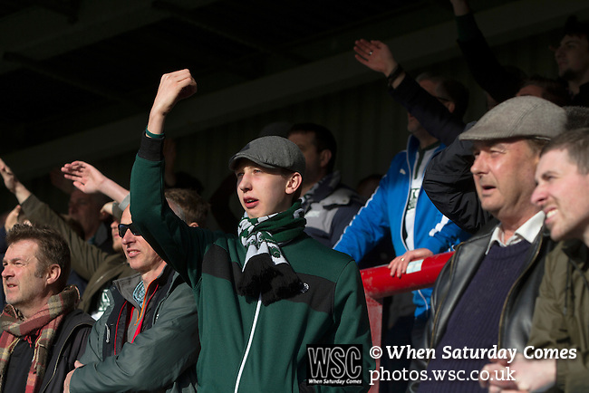 Morecambe 0 Plymouth Argyle 2, 25/03/2016. Globe Arena, League 2. A visiting fan gesturing to opponents after an incident in the first-half as Morecambe hosted Plymouth Argyle in a League 2 fixture at the Globe Arena. The stadium was opened in 2010 and replaced Morecambe's traditional home of Christie Park which had been their home since 1921, the year after their foundation. Plymouth won this fixture by 2-0 watched by 2,081 spectators, in a game delayed by 30 minutes due to traffic congestion affecting travelling Argyle fans. Photo by Colin McPherson.