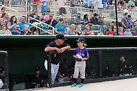 Kannapolis Intimidators manager Justin Jirschele (9) talks to Betty Altschuler, who was the guest manager for the night, prior to the game against the Hickory Crawdads at Kannapolis Intimidators Stadium on April 22, 2017 in Kannapolis, North Carolina.  The Intimidators defeated the Crawdads 10-9 in 12 innings.  (Brian Westerholt/Four Seam Images)