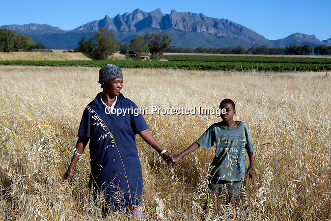 CAPE TOWN, SOUTH AFRICA - NOVEMBER 27:  Raquel Pietersen holds tight to her son Tiyan, age 12,  on November 27, 2015 outside Cape Town, South Africa. Tiyan suffers from FAS, Fetal Alcohol Syndrome, where the mother drank a lot of alcohol during pregnancy. Many wine workers in South Africa had part of their salary paid in wine. These children are usually slow learners and many are underdeveloped and can't function in a normal society. (Photo by: Per-Anders Pettersson)