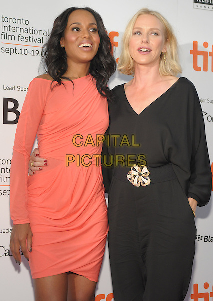 KERRY WASHINGTON & NAOMI WATTS .'Mother And Child' Premiere held at Roy Thomson Hall during the 2009 Toronto International Film Festival,  Toronto, Ontario, Canada, 14th September 2009..half length black catsuit jumpsuit waist belt gold buckle coral orange peach dress long sleeved sleeves ruched arm around waist .CAP/ADM/BPC.©Brent Perniac/Admedia/Capital Pictures