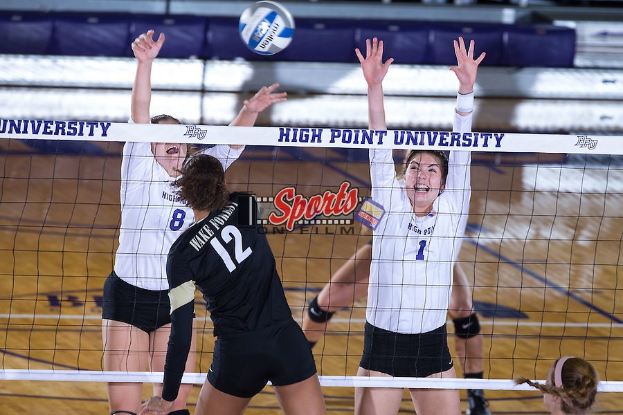 Jordan Hefner (1) and Gabi Mirand (8) of the High Point Panthers attempt to block a shot during the match against the Wake Forest Demon Deacons at the Panther Invitational at the Millis Athletic Center on September 12, 2015 in High Point, North Carolina.  The Demon Deacons defeated the Panthers 3-1.   (Brian Westerholt/Sports On Film)