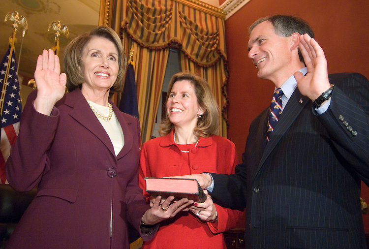 From left, Speaker of the House Nancy Pelosi, D-Calif., Marcia Latta and Rep. Bob Latta, R-Ohio, particpate in his mock swearing-in ceremony after being sworn in on the floor of the House on Thursday, Dec. 12, 2007.