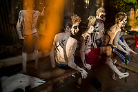 Salvadoran boys, having white body paint with black symbols, perform during the La Calabiuza parade at the Day of the Dead festivity in Tonacatepeque, El Salvador, 1 November 2016. The festival, known as La Calabiuza since the 90s of the last century, joins Salvador's pre-Hispanic heritage and the mythological figures (La Sihuanaba, El Cipitío, La Llorona etc.) collected from the whole Central American region, together with the catholic All Saints Day holiday and its tradition of honoring the dead relatives. Children and youths only, dressed up in scary costumes and carrying painted carts, march from the local cemetery to the downtown plaza where the party culminates with music, dance, drinking and eating pumpkin (Ayote) with honey.
