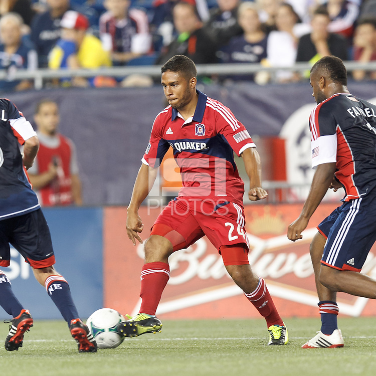 Chicago Fire substitute forward Quincy Amarikwa (24) flicks a pass. In a Major League Soccer (MLS) match, the New England Revolution (blue) defeated Chicago Fire (red), 2-0, at Gillette Stadium on August 17, 2013.