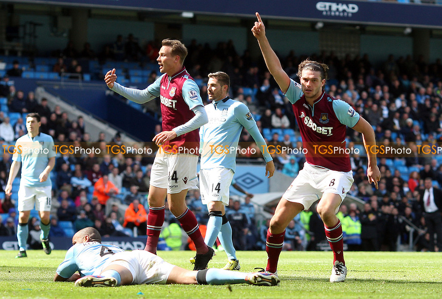 Andy Carroll scores the 1st goal for West Ham and celebrates - Manchester City vs West Ham United, Barclays Premier League at the Etihad Stadium, Manchester - 27/04/13 - MANDATORY CREDIT: Rob Newell/TGSPHOTO - Self billing applies where appropriate - 0845 094 6026 - contact@tgsphoto.co.uk - NO UNPAID USE.