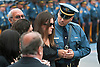 """Now a Widow"".Stephanie Castellano is comforted as she's escorted into  church at funeral of her husband, NJ State Trooper Marc K. Castellano, who was struck by a car on Interstate 195 in Howell last Sunday.  Funeral Mass was at St. Veronica's Roman Catholic Church in Howell.  06/12/10"