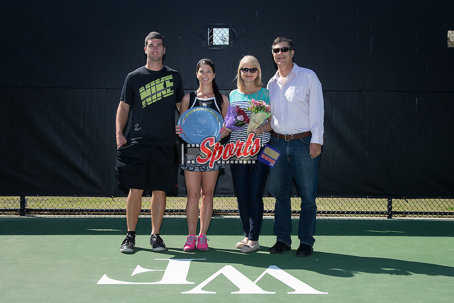 Karen Forman (second from left) is recognized on Senior Day prior to the match against the North Carolina State Wolfpack at the Wake Forest Tennis Center on April 11, 2015 in Winston-Salem, North Carolina.  The Demon Deacons defeated the Wolfpack 4-3.    (Brian Westerholt/Sports On Film)
