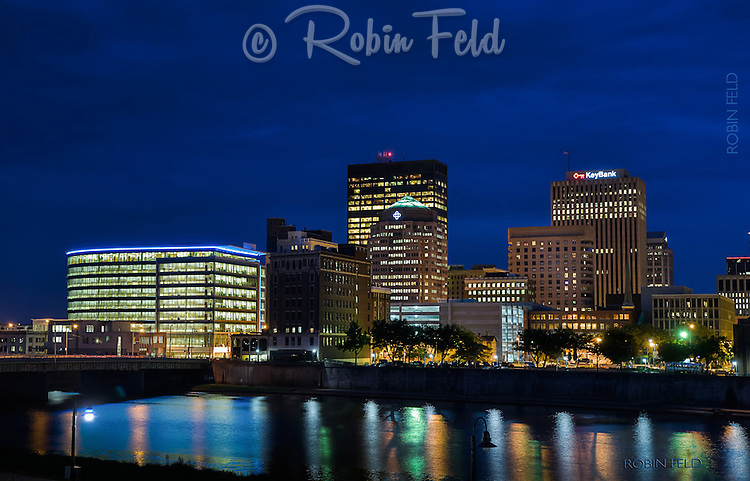 Dayton Ohio skyline at night with river, cityscape of buildings and architecture in Dayton Ohio