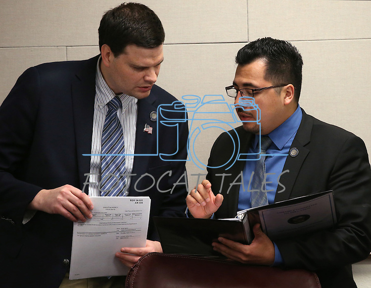 Nevada Assemblymen David Gardner, left, and Edgar Flores, D-Las Vegas, work in committee at the Legislative Building in Carson City, Nev., on Friday, April 10, 2015. <br /> Photo by Cathleen Allison