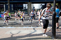 17 APR 2011 - LONDON, GBR - Jessica Hedenskog takes a few seconds from running to stretch during the London Marathon .(PHOTO (C) NIGEL FARROW)