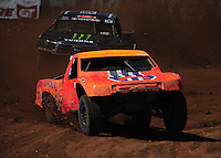 Apr 16, 2011; Surprise, AZ USA; LOORRS driver Adrian Cenni (11) leads Johnny Greaves (16) during round 3 at Speedworld Off Road Park. Mandatory Credit: Mark J. Rebilas-.