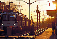 A commuter leaves the Shaker Square Rapid near sunset. A Commuter. Cleveland Ohio USA.