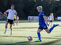 Seattle, WA - Saturday July 22, 2017: Kelley O'Hara, Megan Rapinoe during a regular season National Women's Soccer League (NWSL) match between the Seattle Reign FC and Sky Blue FC at Memorial Stadium.