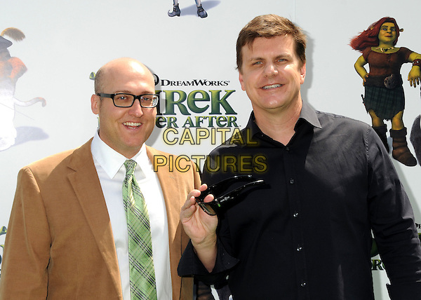 "MIKE MITCHELL, Director & MICHAEL V. LEWIS of RealD 3D.""Shrek Forever After"" Los Angeles Premiere held at the Gibson Amphitheatre, Universal City, California, USA..May 16th, 2010.half length shirt tie jacket black shirt brown white green glasses .CAP/ADM/BP.©Byron Purvis/AdMedia/Capital Pictures."