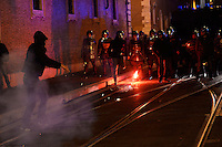 Un manifestante lancia un fumogeno verso la polizia. A protester throws a smoke bomb toward the police <br /> Roma 20-11-2013 Manifestazione movimenti NO TAV. <br /> Protest against the Turin-Lyon high speed train line<br /> Foto Andrea Staccioli / Insidefoto