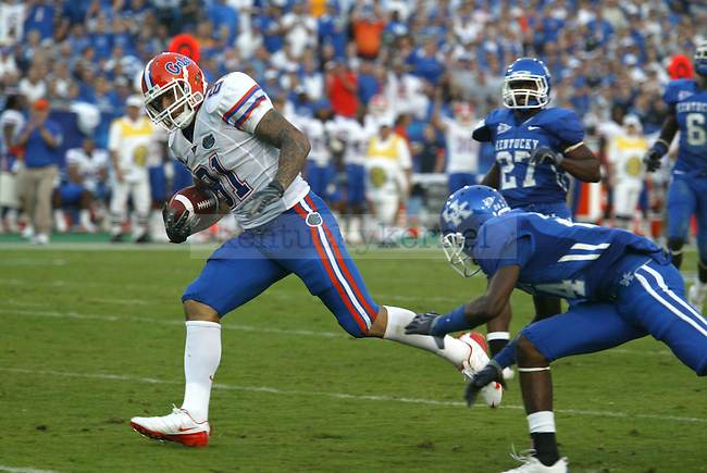 Florida junior tight end Aaron Hernandez is tackled by a UK player during the first half of the game played at Commonwealth Stadium on Sept. 26, 2009. Florida beat UK 41-7. Photo by Zach Brake\Staff