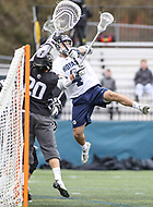 Washington, DC - April 7, 2018: Georgetown Hoyas Daniel Bucaro (4) attempts a shot during game between Providence and Georgetown at  Cooper Field in Washington, DC.   (Photo by Elliott Brown/Media Images International)