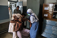 A nun of Missionaries of Charity during work at Prem dan - a home for physically and mentally challenged run by the missionaries of Charity, Kolkata, West Bengal, India. 21st August 2010. Arindam Mukherjee. Missionaries of Charity was founded by Mother Teresa