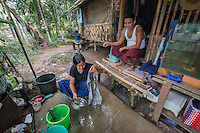 Myanmar,Burma, Yangon. Pa Pa Phyo Swe, works doing laundry by hand for a local university. She'd like to buy a washing machine with her loan. Her husband, Kyaw Kyaw Nyunt,  works as an electrician and combined they make about $8 a day, or about $200 a month. Kyaw Kyaw watches as she does the laundry. He likes her working and the extra income it brings in.