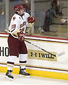 Set - Chris Kreider (BC - 19) celebrates his second period goal which made it 4-2 BC. - The Boston College Eagles defeated the visiting Boston University Terriers 5-2 on Saturday, December 4, 2010, at Conte Forum in Chestnut Hill, Massachusetts.
