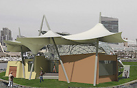 Symphony Summer Pops, North Wing. Back of stage has main entrance covered by the fabric structural elements which juxtaposes the material sensibility conveyed by the steel of the shell and gives needed privacy to the players. Mitra Kanaani, architect.