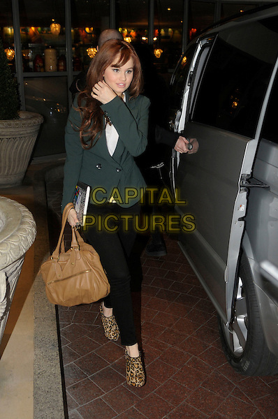 Debby Ryan.outside her her hotel in London, England 12th January 2012..full length car leopard print ankle boots beige tan bag  green blazer jacket .CAP/IA.©Ian Allis/Capital Pictures.