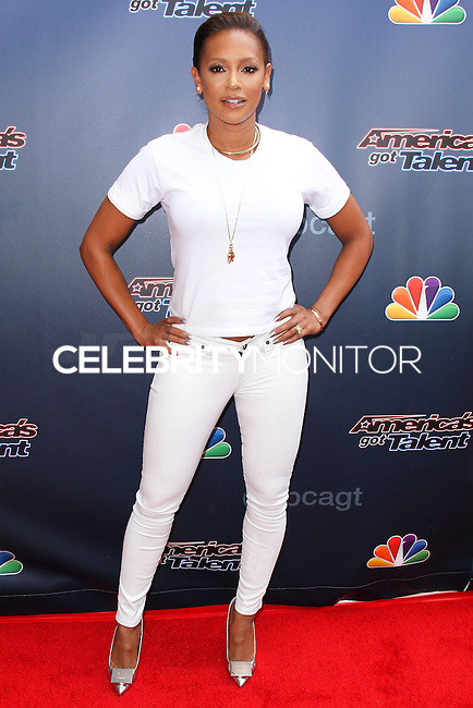 HOLLYWOOD, LOS ANGELES, CA, USA - APRIL 22: Recording Artist Mel B arrives at NBC's 'America's Got Talent' Red Carpet Event held at the Dolby Theatre on April 22, 2014 in Hollywood, Los Angeles, California, United States. (Photo by Xavier Collin/Celebrity Monitor)