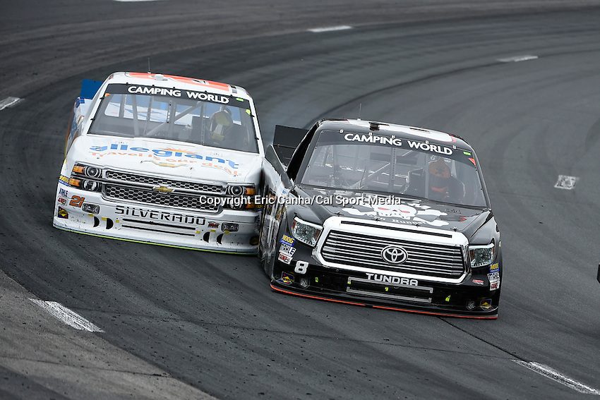 September 19, 2014 - Loudon, New Hampshire, U.S. -  Joey Coulter, NASCAR Camping World Truck Series driver of the #21 Allegiant Travel Chevy truck and John Hunter Nemechek (8) do battle during the NASCAR Camping World Truck Series UNOH 175 race held at the New Hampshire Motor Speedway in Loudon, New Hampshire.   Eric Canha/CSM