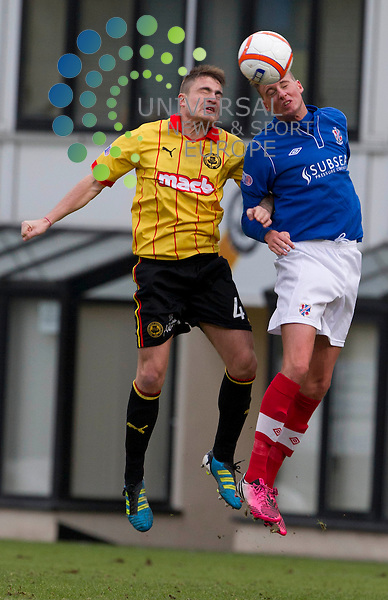 Paul Paton takes Lewis Coult during the Irn Bru Division One Partick Thistle v Cowdenbeath at Firhill Stadium..Universal News And Sport (Scotland). 26 January 2013 www.unpixs.com.