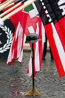 UNGARN, 13.02.2016, Budapest - I. Bezirk.  Gedenken des Ausbruchsversuchs deutscher und ungarischer Stadtverteidiger unter sowjetischer Belagerung am 11. Februar 1945 auf dem Kapisztr&aacute;n-Platz vor dem Kriegsmuseum. Der blutig missglueckte Ausbruch gilt bei den Nazis als &quot;Tag der Ehre&quot;. -Der im Mittelpunkt eines jeden Gedenkens stehende Stahlhelm mit Flaggen der &quot;Hungaristischen Bewegung&quot; und der &quot;Ungarischen Nationalen Front&quot; MNA. | Commemoration of the breakout attempt by German and Hungarian city defenders under Soviet siege, 1945 February 11 on the Kapisztran square in front of the war museum. Nazis regard the fatally failed breakout as &quot;Day of Honor&quot;. -The steel helmet forms the centre of any such commemoration, here together with flags of the  &quot;Hungarist Movement&quot; and the &quot;Hungarian National Front&quot; MNA.<br /> &copy; Martin Fejer/EST&amp;OST