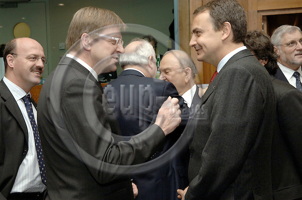 Brussels-Belgium - 15 December 2005---European Heads of State and/or Government meet for a European Council; here, Didier DONFUT (le), State Secretary for European Affairs of Belgium, watching at Guy VERHOFSTADT (ce), Prime Minister of Belgium, and José Luis Rodríguez ZAPATERO (ri), Prime Minister of Spain---Photo: Horst Wagner/eup-images